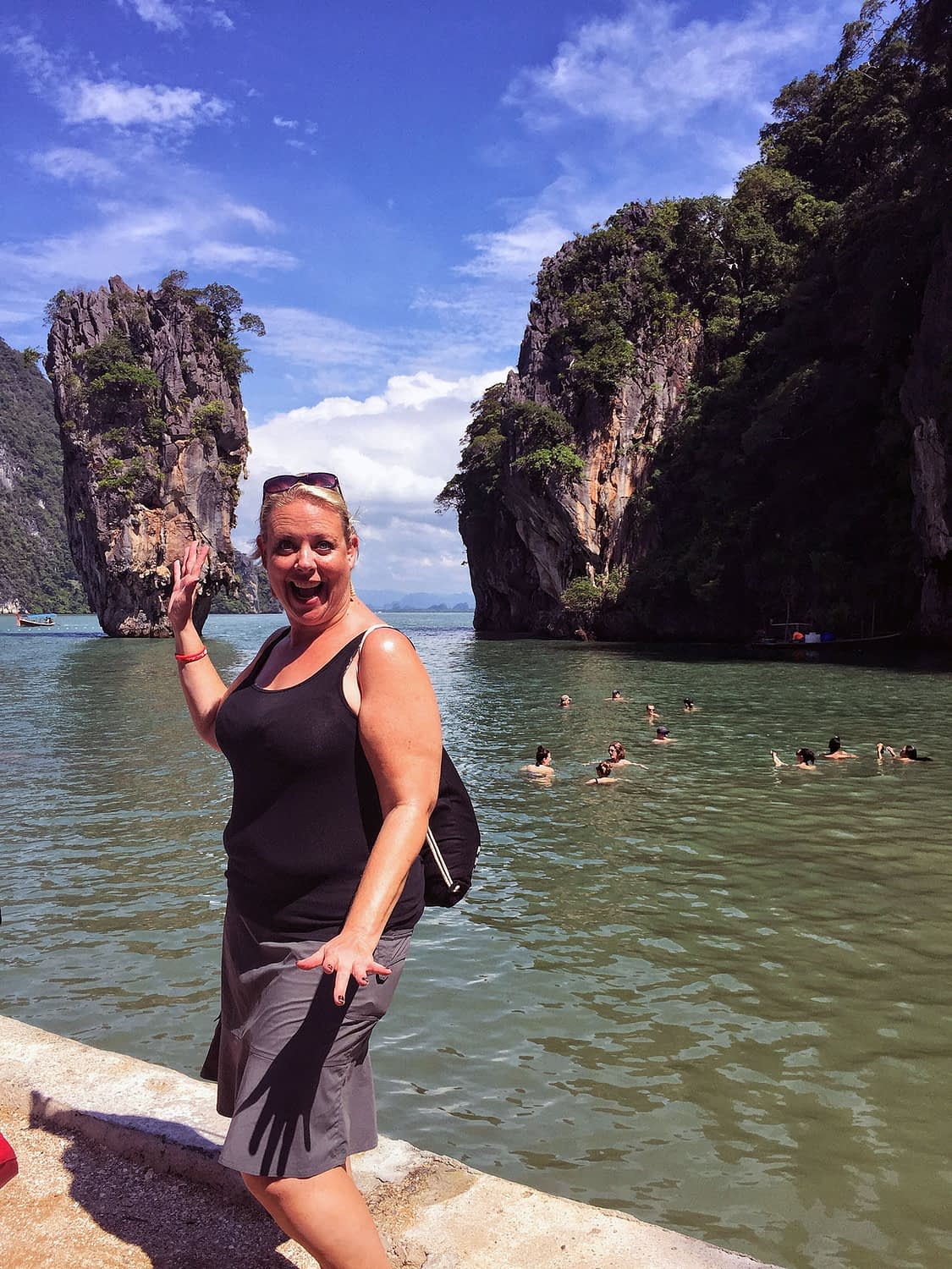 Me standing by green water in Thailand