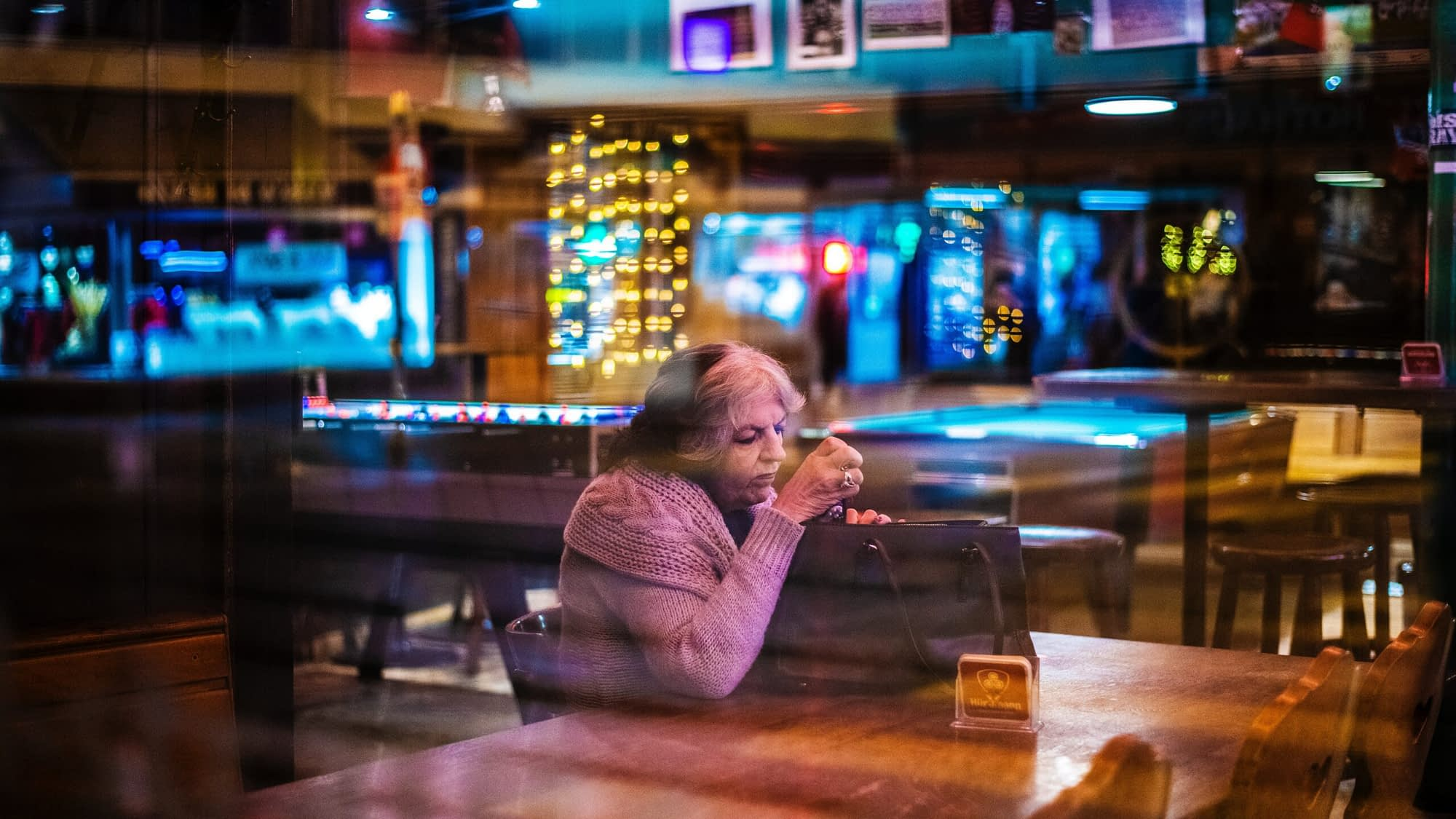 woman sitting alone at a bar